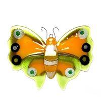 Dekorativ gul sommerfugle i glas